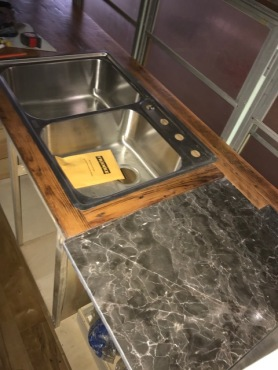 Salvaged marble slab inlaid in barn wood counter tops